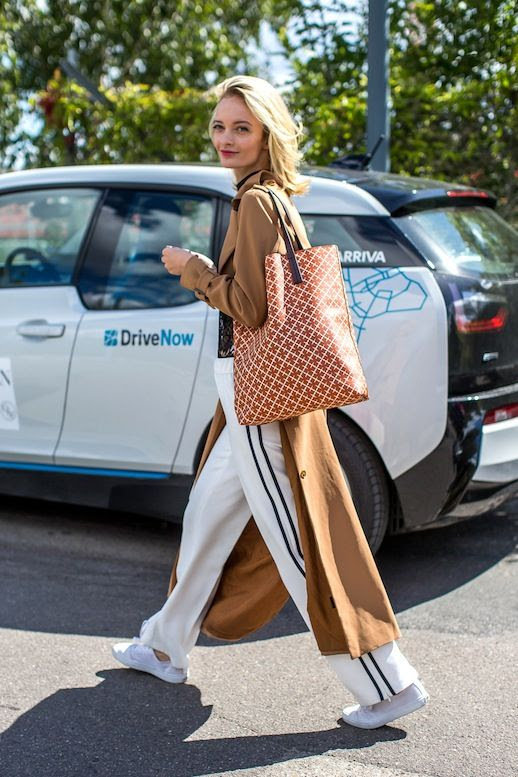 Le Fashion Blog Street Style Camel Trench Coat Black Mock Neck Top Side Stripe Pants Structured Leather Print Tote White Sneakers Via Harpers Bazaar