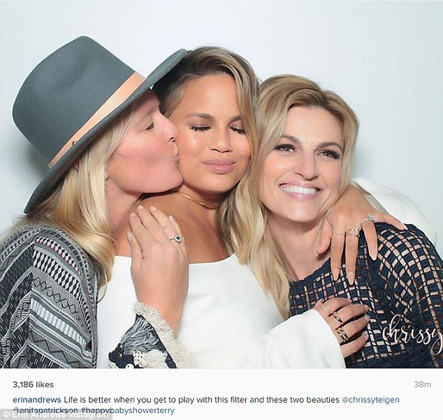 Pucker up: Sportscaster Erin Andrews, right, shared a photo with a blissful-looking Chrissy and celebrity stylist Anita Patrickson, left