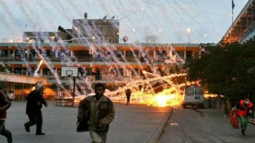 An Israeli attack on a U.N. school in Beit Lahiya with white phosphorus munitions on January 17, 2009. Such attacks constitute war crimes under international law. (Photo: Muhammad al-Baba)