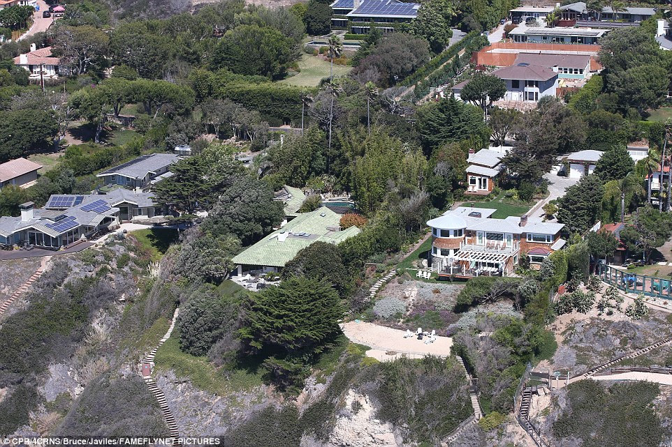 Pricey pad: The five bedroom, five bath home is 4,409-square-feet and worth close to $12 million is located on a stretch of Malibu favoured by celebrities for its seclusion and the family can now claim Owen Wilson, Rick Rubin, Anthony Hopkins, Julia Roberts, Sean Penn, and Matthew McConaughey as neighbors