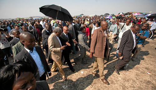 South African President Jacob Zuma along with others near the area where 34 Marikana miners were killed by police. Zuma is coming under pressure from the ANC. by Pan-African News Wire File Photos