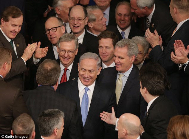 WILD APPLAUSE: Netanyahu spoke to an enthusiastic and cheering House chamber on Tuesday