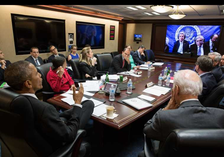 President Barack Obama, Vice President Joe Biden, and White House aides receive an update