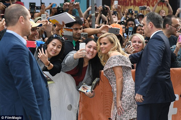 She's got this: Bodyguards kept a watchful eye on the star who was determined to make a few fans' days