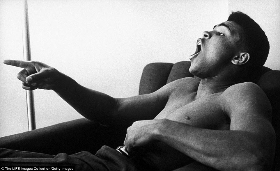 In Pittsburgh in 1963, Ali reclines bare-chested in his hotel room; in his next fight he beat Charlie Powell inside three brutal rounds