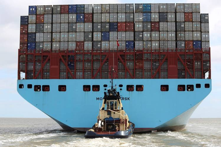 A tugboat works behind a Triple-E Class container ship operated by Maersk as it leaves the port of Felixstowe, U.K., in April. The Maersk Line said it would cancel options to buy six new Triple-E vessels—the world's largest container ships.