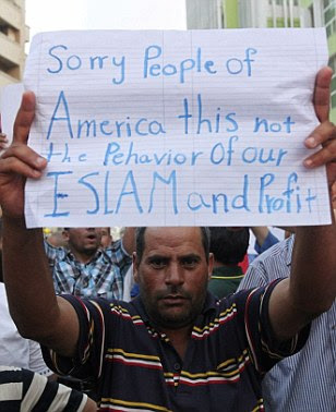 One protester in Benghazi, Libya shows that he is eager to get a message through to Americans