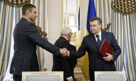Vitali Klitschko, leader of Ukraine's UDAR opposition party shakes hands with Ukrainian President Viktor Yanukovych after the signing of the Agreement in the Presidential Palace in Kiev.