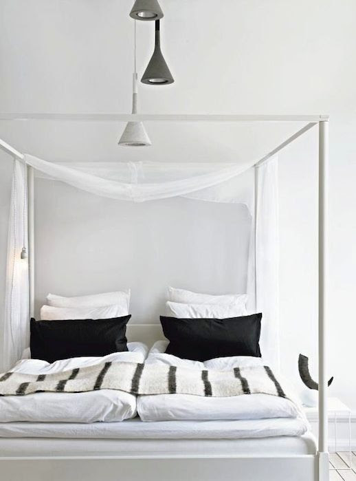 Le Fashion Blog A Fashionable Home Neutral Chic In Malmo Sweden Nina Bergsten Via Residence Bedroom Canopy Bed Black And White Pillows Stripe Throw Blank Quilt Comforter White and Grey Hanging Light Pendants 7 photo Le-Fashion-Blog-A-Fashionable-Home-Neutral-Chic-In-Malmo-Sweden-Nina-Bergsten-Via-Residence-Bedroom-7.jpg