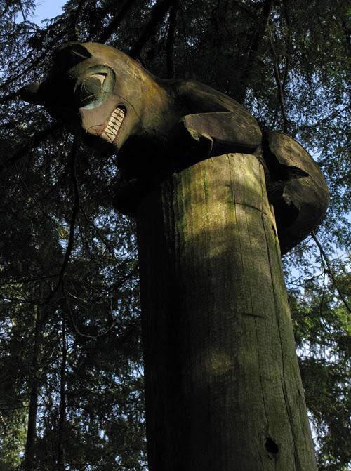 a bear figure atop a memorial totem pole in Kasaan Totem Park, Kasaan, Alaska