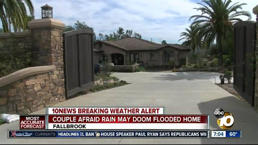 Local couple fears more rain could doom flooded home