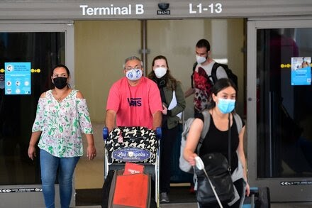 The Biden administration will lift restrictions on fully vaccinated international travelers in November.