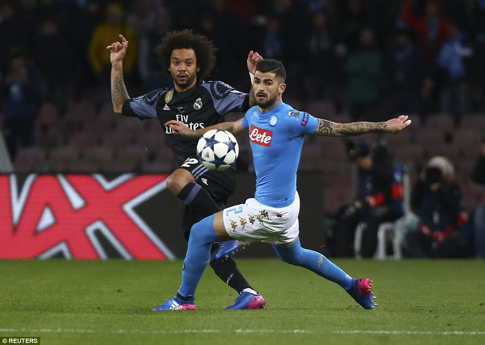 Real Madrid's Marcelo in action with Napoli's Elseid Hysaj during the first half at the Stadio San Paolo