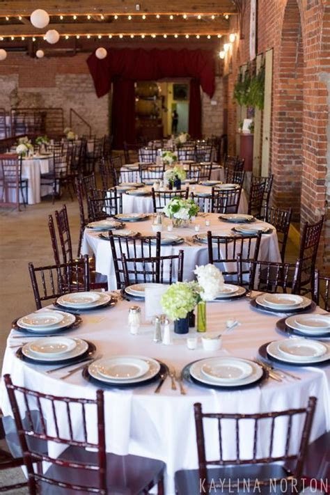 Navy, green, and white wedding table decorations   Via