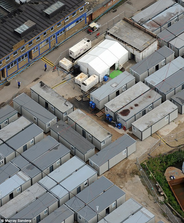 Grim: Cleaners at the Olympic Park are being housed ten to a room at a huge temporary compound, pictured. The campsite in East London, hidden from public view, has 25 people sharing each toilet and 75 to each shower