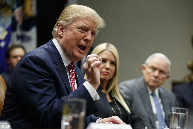 President Donald Trump went back on offense against MS-13 on Friday, complaining that a porous U.S. border is allowing the gang's members to enter the country at will