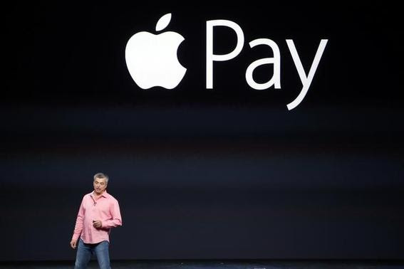 Eddy Cue, Apple's senior vice president of Internet Software and Service, introduces Apple Pay during an Apple event at the Flint Center in Cupertino, California, September 9, 2014. REUTERS-Stephen Lam