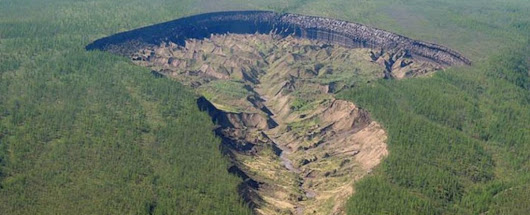 There's a 'Doorway to The Underworld' in Siberia So Big It's Uncovered Ancient Forests
