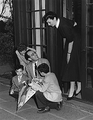 Jonas and Donna Salk with Peter (standing), Darrell (kneeling with back to camera), and Jonathan (kneeling, facing camera) at Inglis House in Ann Arbor, April, 1955, at the time of the announcement of the results of the vaccine field trials. (Courtesy of the family of Jonas Salk)