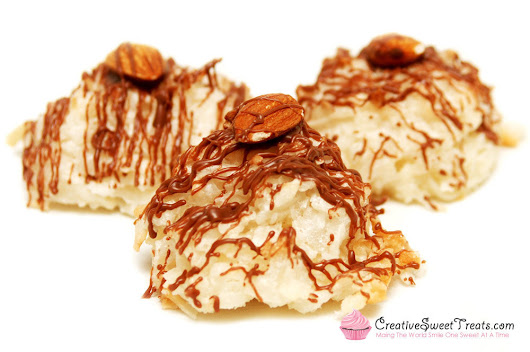 Coconut Macaroons Drizzled in Chocolate and Topped with an Almond Deli – Creative Sweet Treats