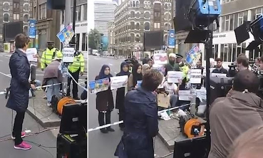 'Fake news' row over video of Muslim protesters behind TV crews