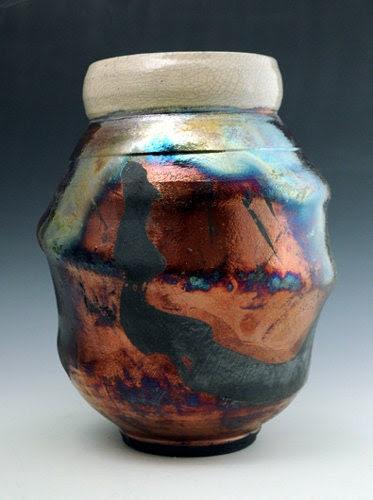 raku vase with copper luster, crackle glaze, and brushwork