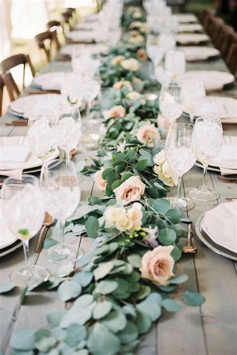 Picture Of a stylish eucalyptus and blush roses table