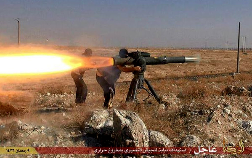 A screenshot showing Syrian rebels using an American made BGM-71 TOW missile.