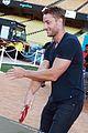 justin hartley brings daughter isabella to charity ping pong tournament 05