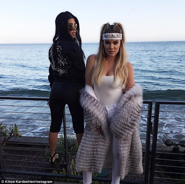 Siblings:  Kourtney spent some time looking out over the ocean as Khloe struck a pose
