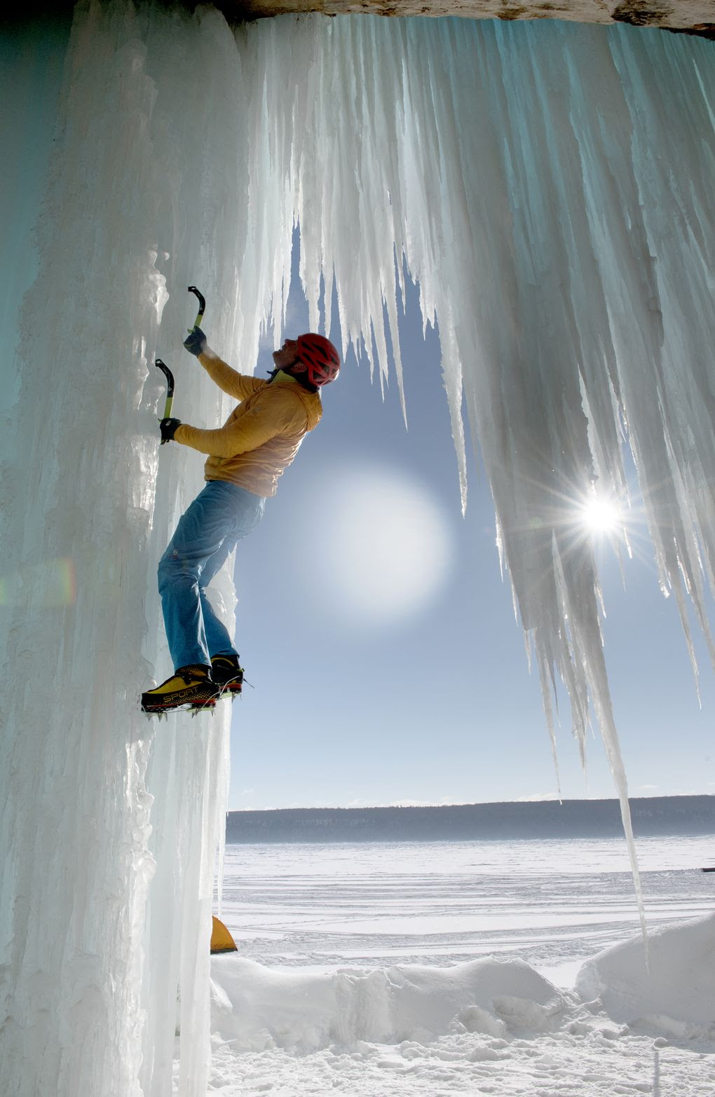 Mountaineer Conrad Anker climbs a frozen waterfall at Upper Michigan's Pictured Rocks National Lakeshore.