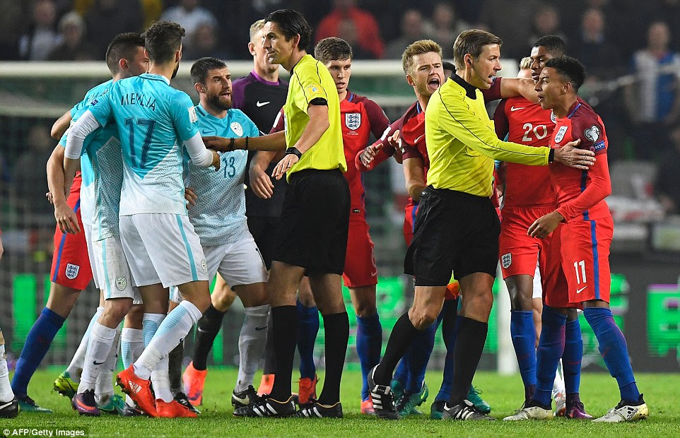 Tempers frayed late in the tie, with Jesse Lingard (right) at the centre of the commotion as his team-mates pulled him away