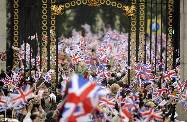 Thousands of people wave Union Jacks as the couple are taken to Westminster Abbey in their open-topped carriage. An estimated one million people lined the streets