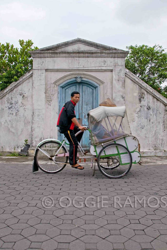 Indonesia - Solo Kraton Becak Against Blue Door