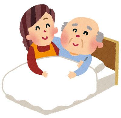 無料素材 ベッドに寝るおばあちゃんを支える介護士さんのイラスト
