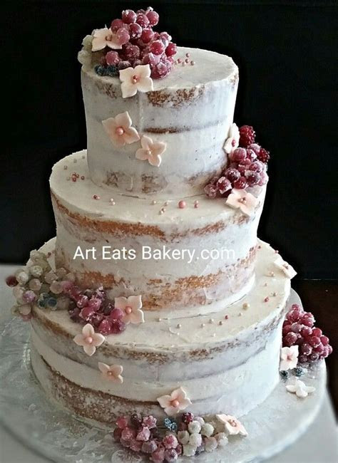 Three tier naked butter cream wedding cake with sugared