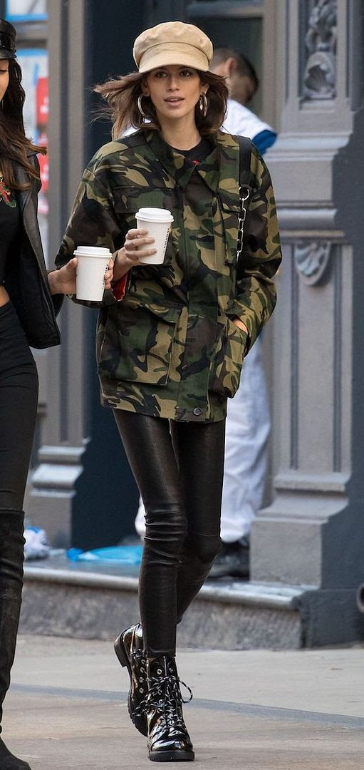 Le Fashion Blog Kaia Gerber Tan Hat Gold Hoops Camo Jacket Leather Pants Combat Boots Via Harpers Bazaar