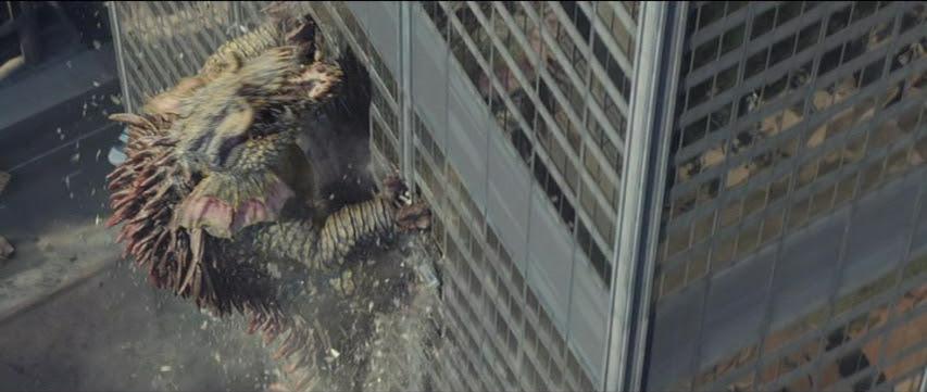 Lizzie climbs a building.
