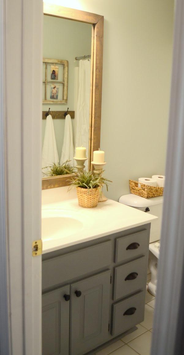 Guest bathroom update - Stained wood framed bathroom mirror