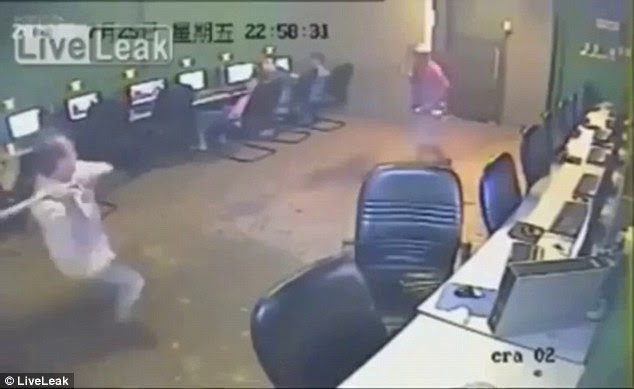 Battle: At first the café owner (left) tried to defend himself with what appeared to be a metal bar