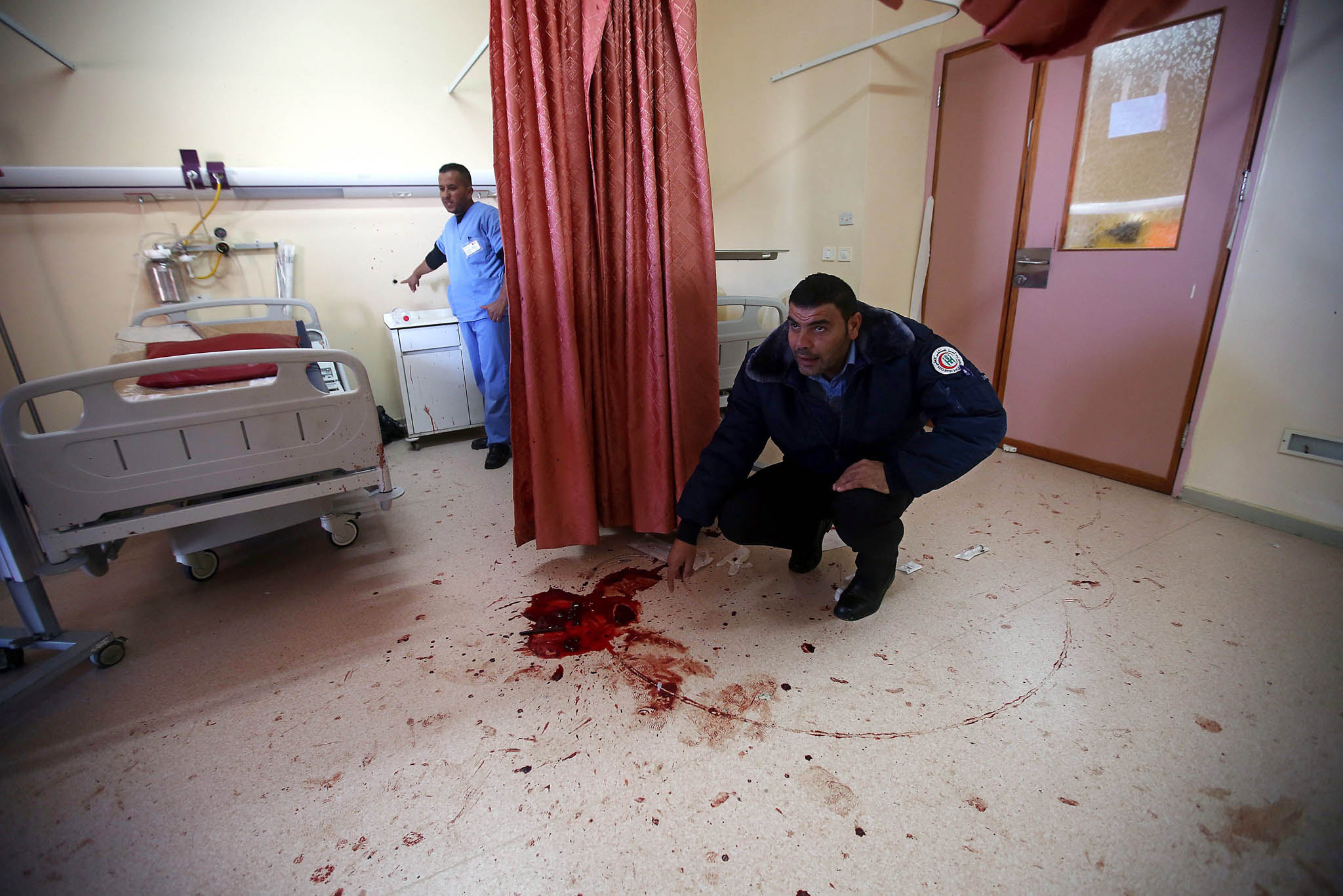 Israeli forces raid West Bank hospital...epa05021437 Palestinian hospital security checks the room where Israeli special forces killed 27 years old Abdallah Shalaldeh and arrested his cousin at the Al-Ahli hospital in the West Bank city of Hebron 12 November 2015. Shalaldeh was shot dead by Israeli special forces during a raid to arrest his cousin Azzam Shalaldeh. An undercover Israeli unit raided a southern West Bank hospital early 12 November, killing one Palestinian and seizing another, the Palestinian Health Ministry said. An Israeli military spokeswoman in Tel Aviv said that security forces had sought to apprehend a Palestinian accused of stabbing an Israeli outside a settlement bloc south of Jerusalem on 25 October 2015. The alleged Palestinian assailant, Azzam Shalaldeh, 20, had been shot by the Israeli victim. The Israeli was, in turn, severely injured with a stab wound to the chest.  EPA/ABED AL HASHLAMOUN ATTENTION EDITORS PICTURE CONTAINS GRAPHIC CONTENT