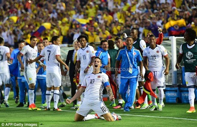 Colombia captain James Rodriguez celebrates after scoring his country's second goal against Paraguay.