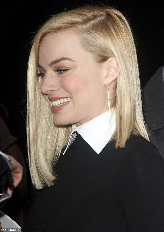 Flawless: The young star had her blonde locks in a razor straight style and wore minimal makeup on her flawless complexion