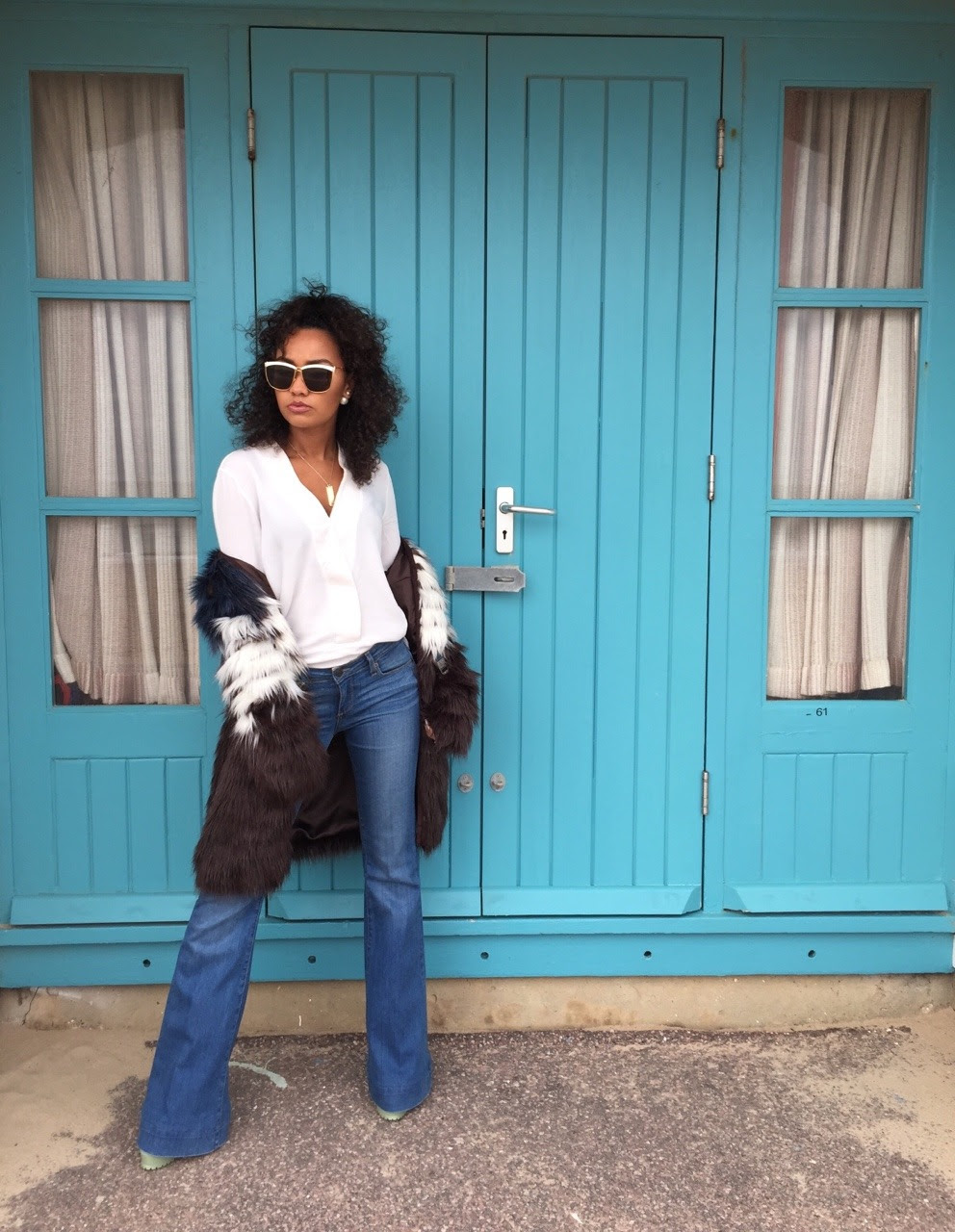 Faux Fur & Flares   LeighLoves the 70's inspired trend for SS15, be sure to pick up your pair of statement flares.  Coat- UrbanCode  Top- Zara   Jeans- Paige   Shoes- Topshop  Sunglasses- Dior