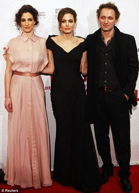 Busy night: The actress poses with the two stars of her film Zana Marjanovic and Goran Kostic