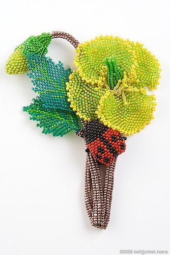 Beaded Flower and Ladybug by neilcreek, via Flickr