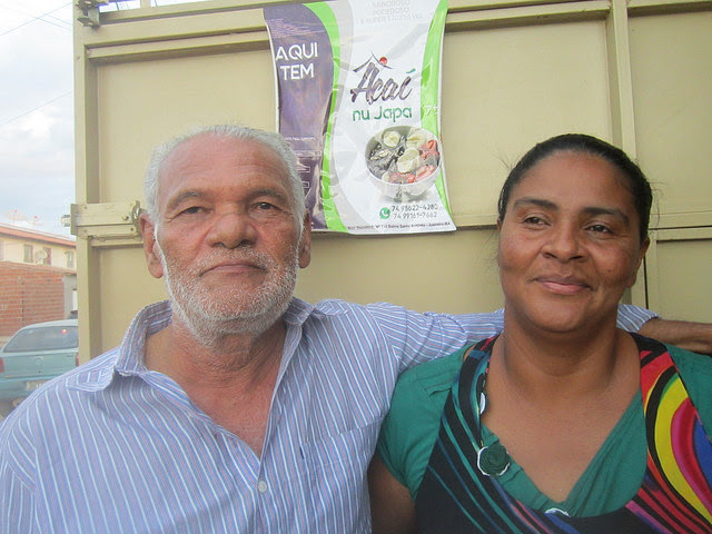 David Lima and his wife Aedna Caravalho pose for pictures in front of the ice cream stand they set up in front of their house in one of the housing complexes on the outskirts of Juazeiro, in northeastern Brazil. As a social and political activist, Lima is working to reactivate the solar project. Credit: Mario Osava/IPS