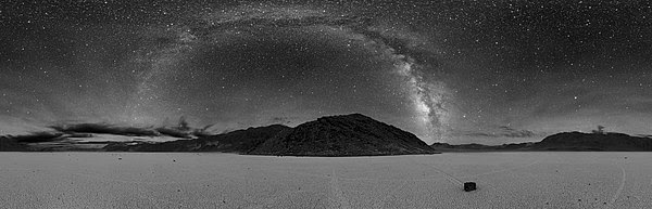 The Milky Way can be seen as a very large streak or arc across the sky if the seeing conditions are good enough. This is a panoramic image.