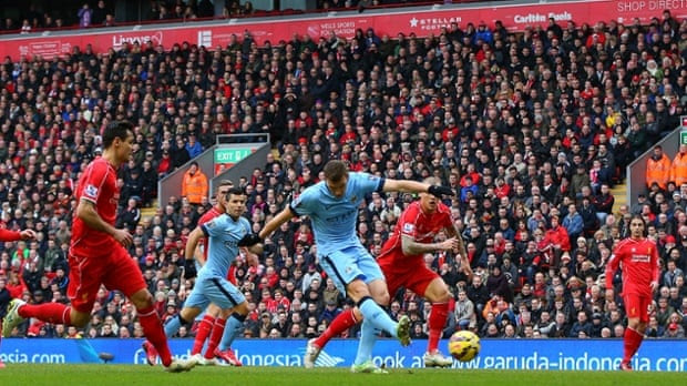 Edin Dzeko of Manchester City scores to make it 1-1.
