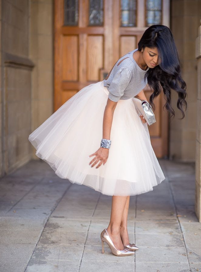 tutu and gray sweater